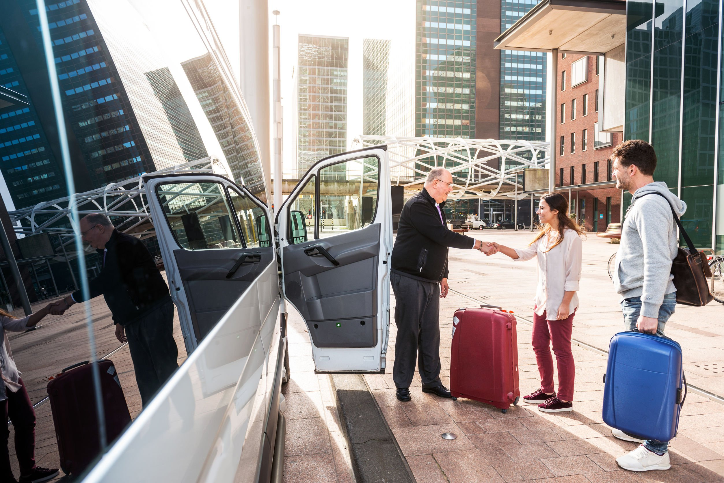 Airport Shuttle driver and passengers in a big city